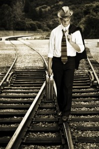 man-walking-on-rr-tracks